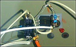 Стабилизатор напряжения с регулируемой нагрузкой для ЗУ